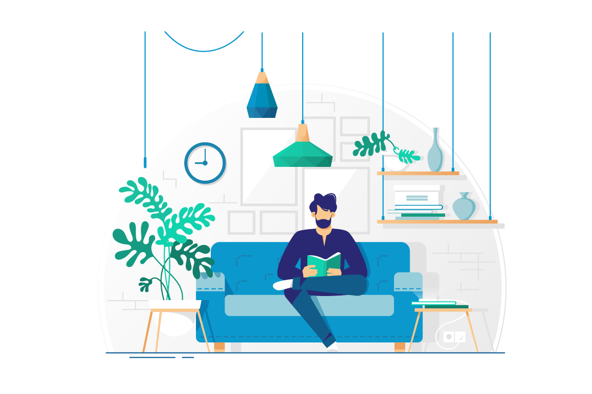 Young man with beard reading book sitting on couch.